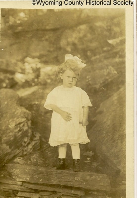 Child with a bow
